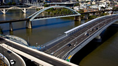 Residents of three suburbs will be granted a toll credit for the Go-Between Bridge (foreground) during the Metro's construction.