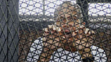 Journalist Peter Greste in the dock of an Egyptian courtroom in 2014.