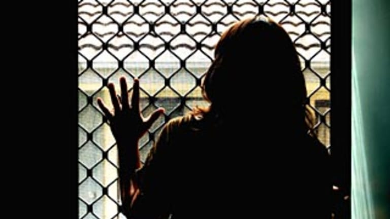 Julie's violent ex-husband will be arrested if he returns to Australia.