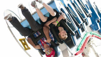 Woman fighting for life after being flung from carnival ride in Cairns