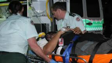 Fuzzy Maiava on a stretcher after he was badly injured on Qantas Flight 72 in 2008.