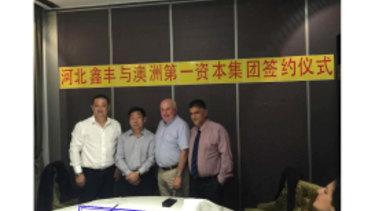 Wensheng Liu, Yuqing Liu, Vince Badalati and Con Hindi at the signing ceremony in Sydney.