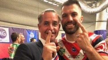 Mind games: The so-called coach whisperer Bradley Charles Stubbs with James Tedesco after the Roosters' grand final win last year.