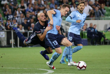 Hard to stop: Sydney FC's Brandon O'Neill holds off James Troisi.
