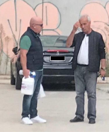 Former V/Line boss James Pinder (left) and Transclean boss George Haritos (right) at a car park in South Yarra. Mr Pinder is holding cleaning equipment.