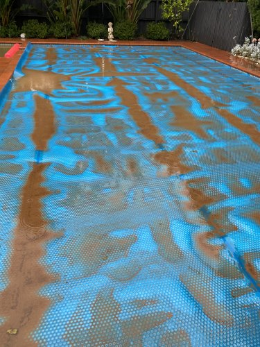 A pool blanket shows the stark effect of the red dust.