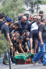 Mourners at the funeral for Nabil Maghnie.