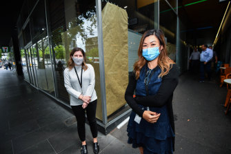 CBD workers Naomi Lions and Teri Tran returned to their office on Tuesday, but would like to continue working from home part-time.