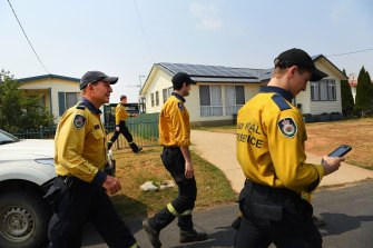 Former prime minister Tony Abbott (left) with the Davidson 1 RFS crew arriving at Adaminaby RFS station on Friday.