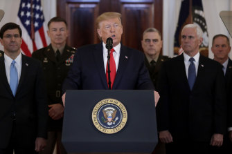 US President Donald Trump was flanked by his vice president, cabinet secretaries and senior military officers in their uniforms.