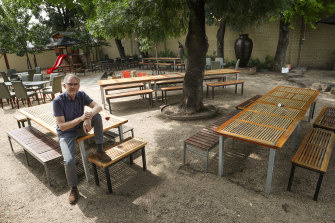 Delatite Hotel owner Dean Belle in the empty beer garden.