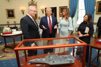 Donald Trump presents Scott Morrison with a model of one of the combat vessels ASX-listed shipbuilder Austal is building for the US Navy.