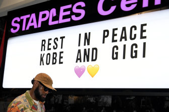 LeBron James of the Los Angeles Lakers arrives for the game against the Portland Trail Blazers as he passes a sign to honor Kobe and Gigi Bryant at Staples Center.
