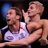Nick Riewoldt fights with Adelaide's Ben Rutten.