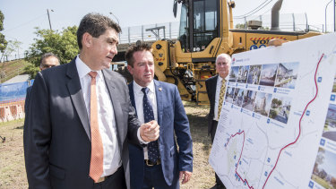 Parramatta MP Geoff Lee, left, and acting Transport Minister Paul Toole mark the start of major construction of the light rail line.