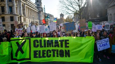 """Students take part in a """"Fridays for Future"""" climate change rally in London. The UK goes to the polls on December 12. The youth climate strike movement started in August 2018, led by the Swedish teenager Greta Thunberg."""