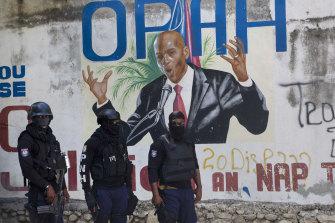 Police basal   adjacent   a mural featuring Haitian President Jovenel Moise, adjacent   the leader's residence wherever  helium  was killed by gunmen.