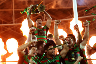 Then-South Sydney captain John Sutton with the NRL trophy in 2014.