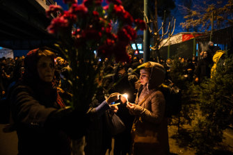 Demonstrators light candles on Saturday while gathering during a vigil for the victims of the Ukraine International Airlines flight that was unintentionally shot down.