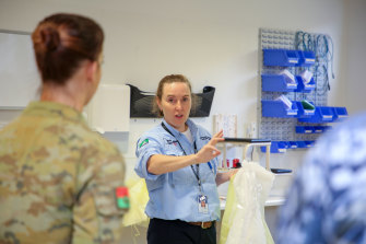 Infection prevention and control adviser Jennifer White briefs defence force health professionals in the North West Regional Hospital in Burnie, Tasmania, after the hospital's formal handover from contracted cleaning personnel.