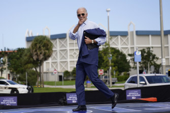 Joe Biden jogs off stage after speaking at a drive-in rally at Broward College in Coconut Creek, Florida, last month.