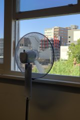 Professor Jason Monty says air flow can be improved by setting up a fan at a window.