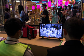 The temperatures of all shoppers entering the Siam Paragon mall in Thailand are monitored in an attempt to curb the coronavirus's spread.