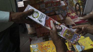 Indians shop for green firecrackers ahead of Diwali festival in Delhi.