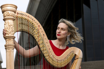 Harpist Georgia Lowe has lost 40 to 50 per cent of her income in the shutdown.