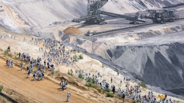 Activists climb into the Garzweiler lignite mine in Germany on June 22 as part of a protest against coal mining.