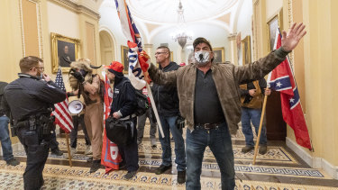 Supporters of President Donald Trump are confronted by US Capitol Police officers.