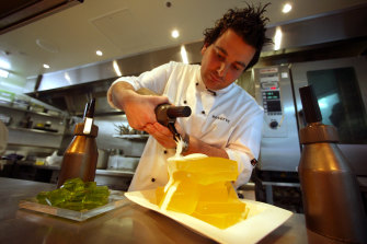 Spiky-haired and hungry in 2003, George Calombaris pours champagne foam over gin and tonic jelly at Reserve.