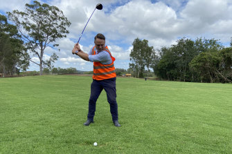 Brisbane lord mayor Adrian Schrinner in the swing of things on the 13th at Brisbane's new Minnippi Golf Course.
