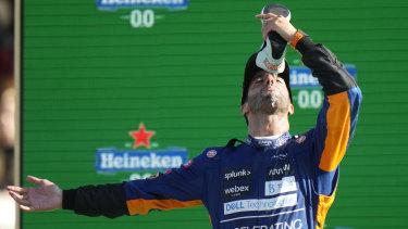 Daniel Ricciardo celebrates his victory in trademark style at Monza in Italy.