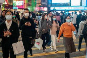 Pedestrians wear face masks in Hong Kong amid the coronavirus outbreak.