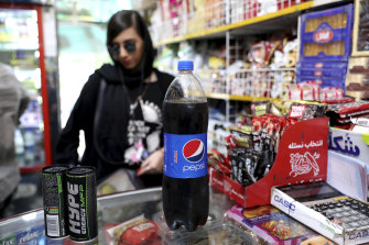 US sanctions on Iran no barrier to trendy Tehran cafes getting hold of  Coca-Cola and American cigarettes