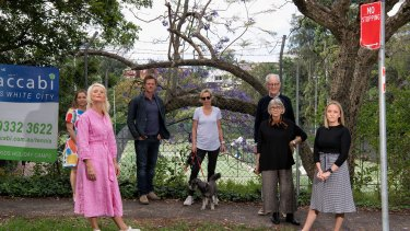 Woollahra councillor Harriet Price (second from left) and local residents outside the White City tennis centre.
