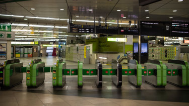 Shinjuku Station, usually one of the world's busiest railway stations, lies empty as all train services are suspended.