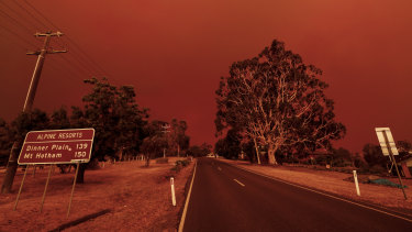 The sky turns red as fires close in on Omeo on January 4.