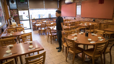 Waiter Jun Heng served five people at Dumpling King on Monday, down from as many as 40 on a regular day.