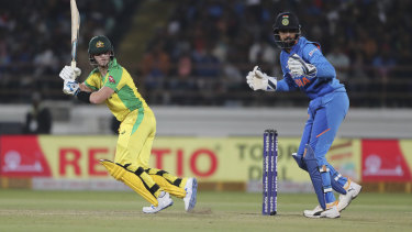 Steve Smith collects more runs but his half-century was not enough for the tourists.