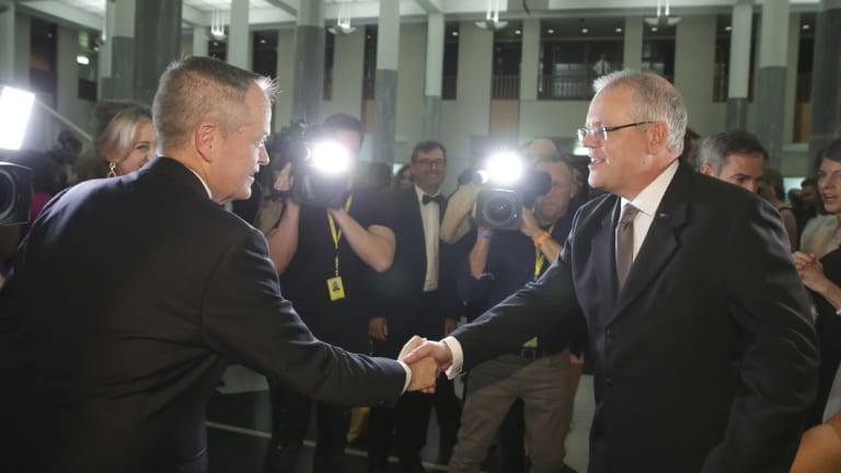 Corporate advisor John Connolly won the bidding on the charity auction for a drink with Bill Shorten, pictured here with Scott Morrison at Wednesday's Midwinter Ball.