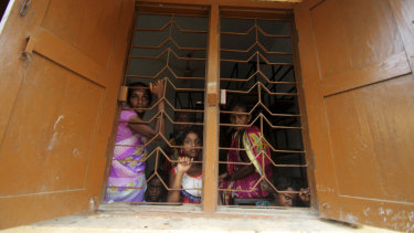 Villagers of Chandrabhaga fishing village take shelter at a government run school building after they were evacuated by the authorities in the Puri district of eastern Odisha state, India.