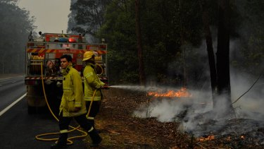 The NT firefighters have been working up to 15 hours a day on a six-day rotation in NSW.