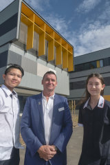 Homestead students Amelia Blake and Hayden Chan with founding school principal Michael Fawcett at the school grounds in Point Cook.