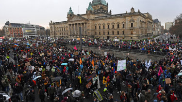 Thousands of demonstrators attend a protest climate strike ralley of the 'Friday For Future Movement' in front of the Federal Administrative Court building in Leipzig, Germany, on Friday.