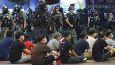 Hong Kong police detain protesters against the new security law during a march last week.