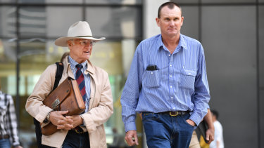 Charleville grazier Dan McDonald (right), accompanied by the federal member for Kennedy Bob Katter, outside the District Court in Brisbane on Tuesday.