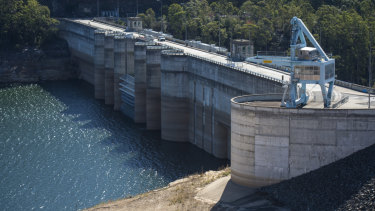 Warragamba Dam, now sitting at about 50 per cent full. The government says lifting the wall by 14m would reduce downstream flood damage.
