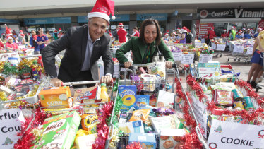 Stocking up: Locals join in the Fairfield Uniting Church Christmas shopping trolley drive earlier this month.